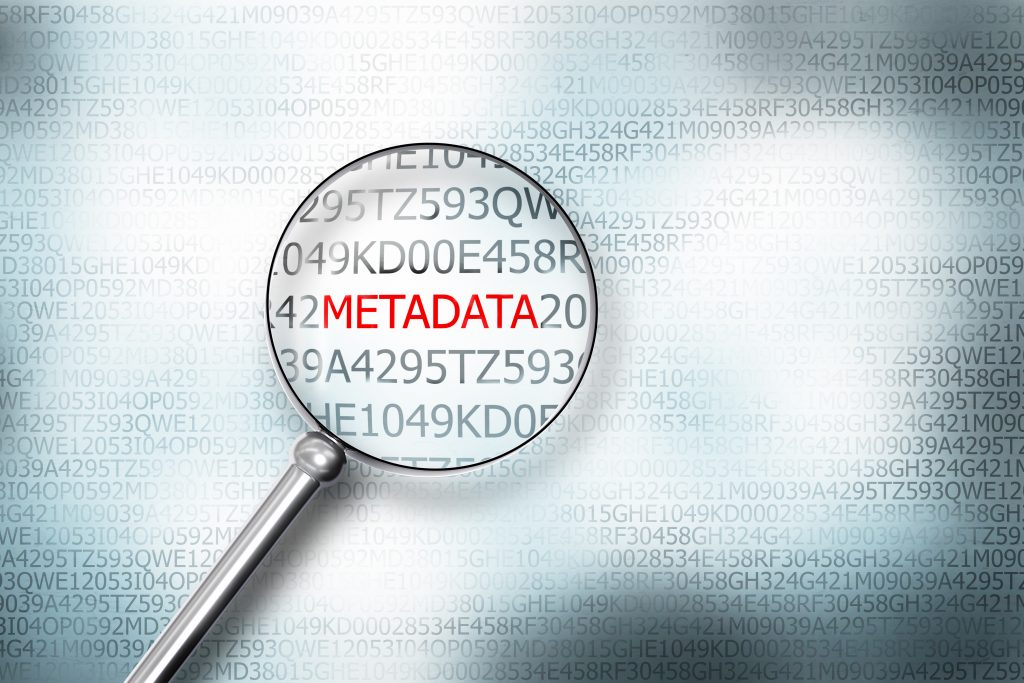 reading metadata on digital computer screen with a magnifying glass internet security